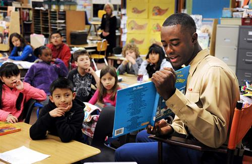 Marine reading to students